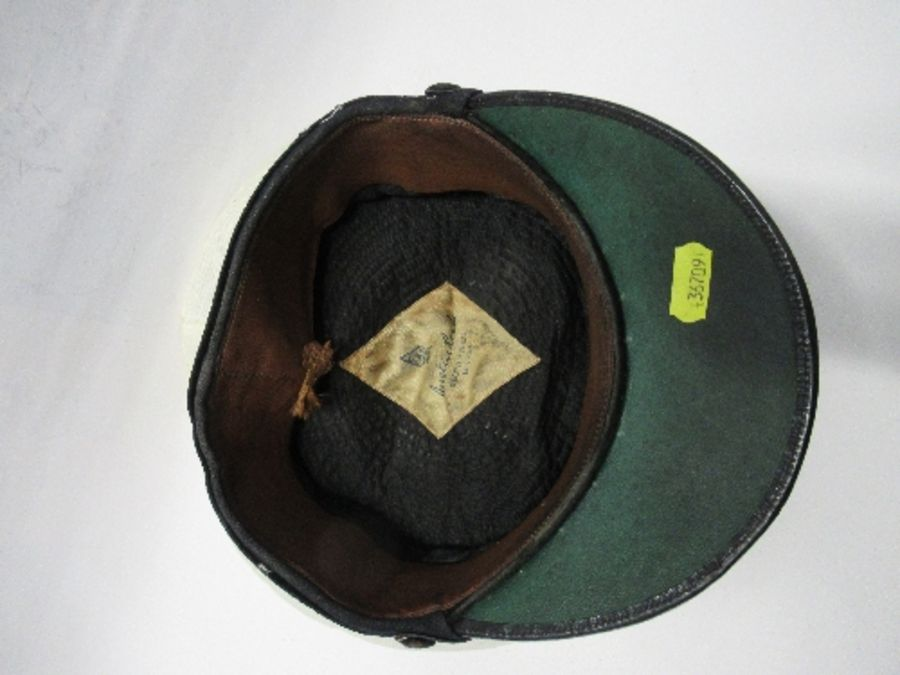 A British naval style visor cap in white cotton, with anchor and crown to the front on a black hat - Image 6 of 13