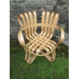 An armchair of cross check in bent and laminated wood after Frank Gehry
