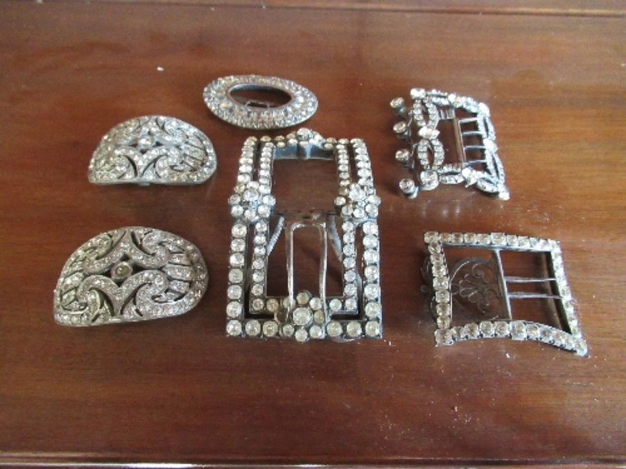 Six various 19th century paste and steel buckles