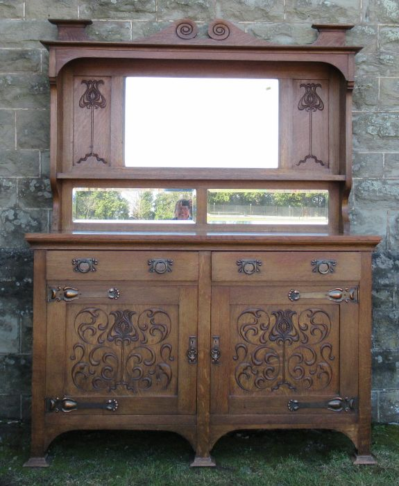 A Liberty style oak Art Nouveau mirror back sideboard, with copper mounts, width 59.5ins, depth