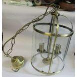 A gilt metal two branch ceiling lantern, with glass panels, height approx 15ins