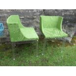 A pair of Perspex and green upholstered chairs