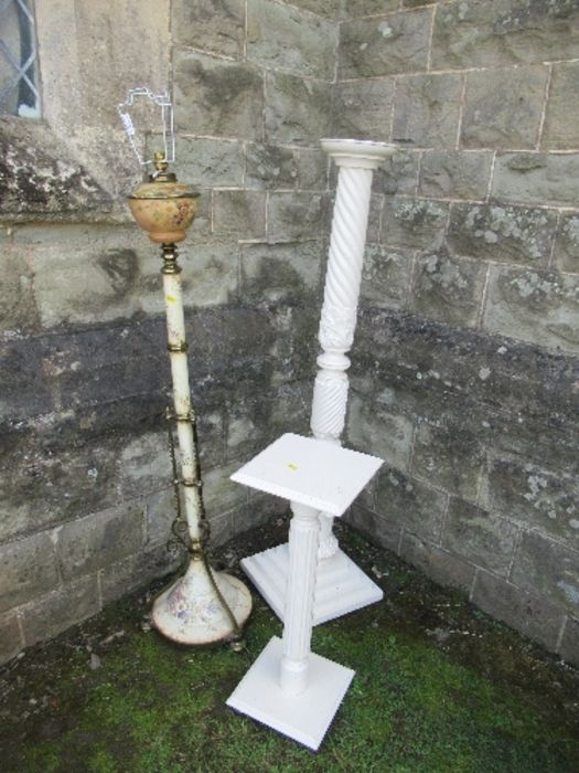 A telescopic oil lamp base, together with two painted plant stands