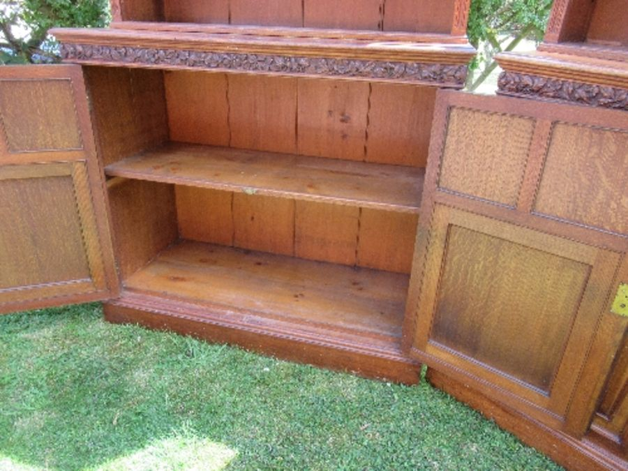 A pair of late 19th century oak bookcases, fitted open shelves to the upper section, and a further - Image 6 of 7