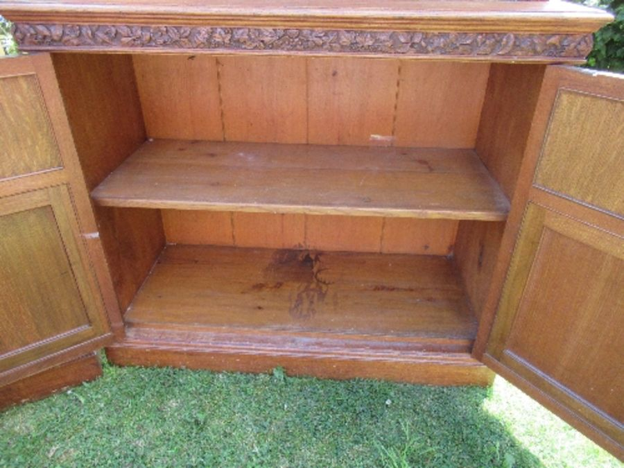 A pair of late 19th century oak bookcases, fitted open shelves to the upper section, and a further - Image 7 of 7