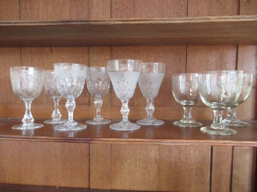 Nine various rummers and wine glasses, having engraved and etched bowls