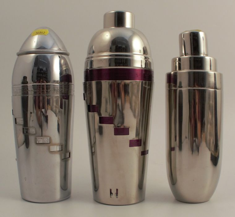 Three silver plated cocktail shakers, two with ingredients for different cocktails