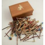A large collection of 20th century lace bobbins, in wood, bone, stained and glass, most decorated