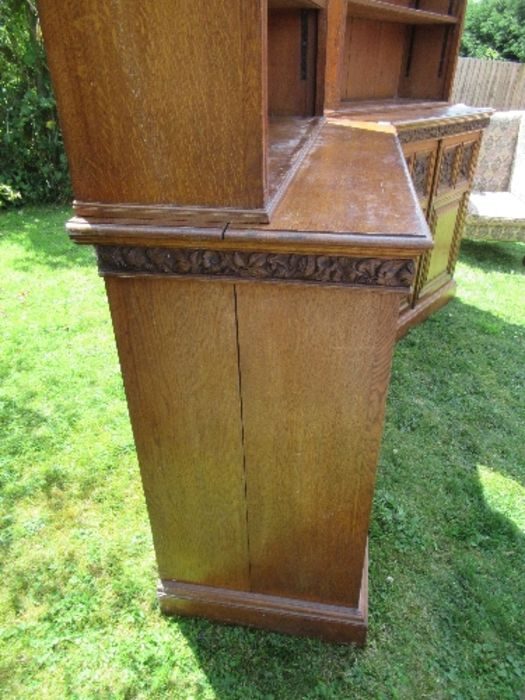 A pair of late 19th century oak bookcases, fitted open shelves to the upper section, and a further - Image 4 of 7