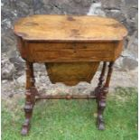 A Victorian burr walnut work table, with a marquetry top, fitted with a drawer and wool box below,