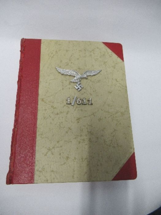 A World War 2 Luftwaffe document group, to include Third Reich style 1/611 photograph album with