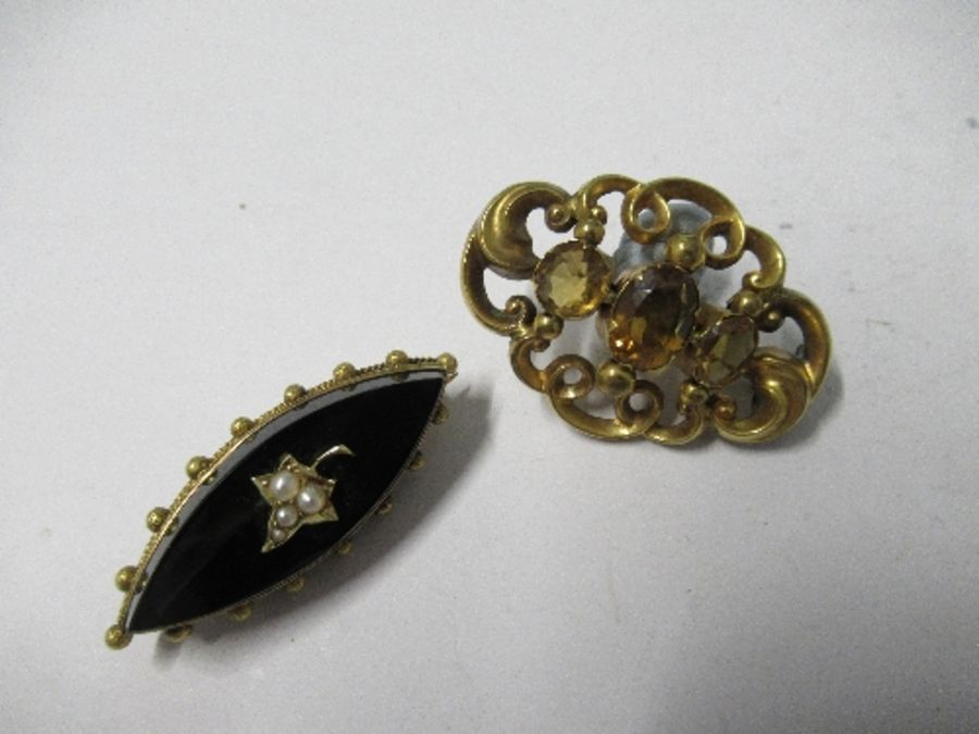 A Victorian three stone citrine brooch, of scroll work design, together with a Victorian locket back