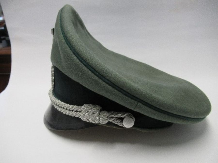 A Third Reich style visor cap, in green felt fabric with dark green piping and hat band, silver - Image 3 of 5