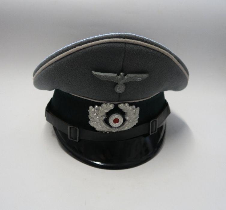 WW2 style German Officer's visor cap, bearing label Stirndrukfrei Deutsches Reichspatent