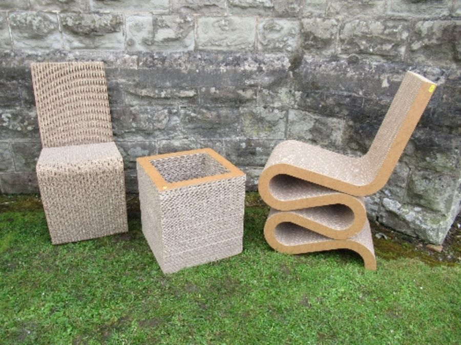 A pair of Wriggle, cardboard chairs and a table after Frank Gehry