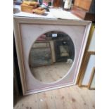 A wall mirror, the oval mirror plate with marble effect surround, maximum diameter 23ins, together