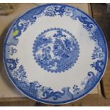 A large circular plate, decorated in printed blue and white, diameter 16.5ins