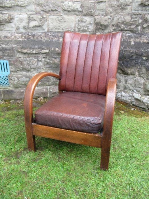 An Art Deco leather open armchair