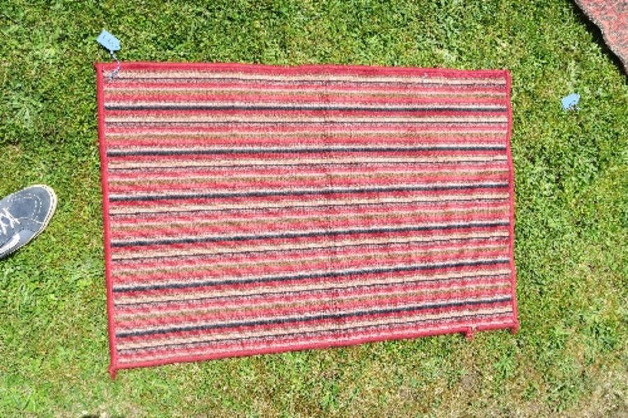 Four Eastern mats, all decorated with different designs to a red ground, all approximately 20ins x - Image 2 of 6