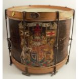 A wooden drum, painted with a coat of arms, diameter 16ins, height 13.75ins