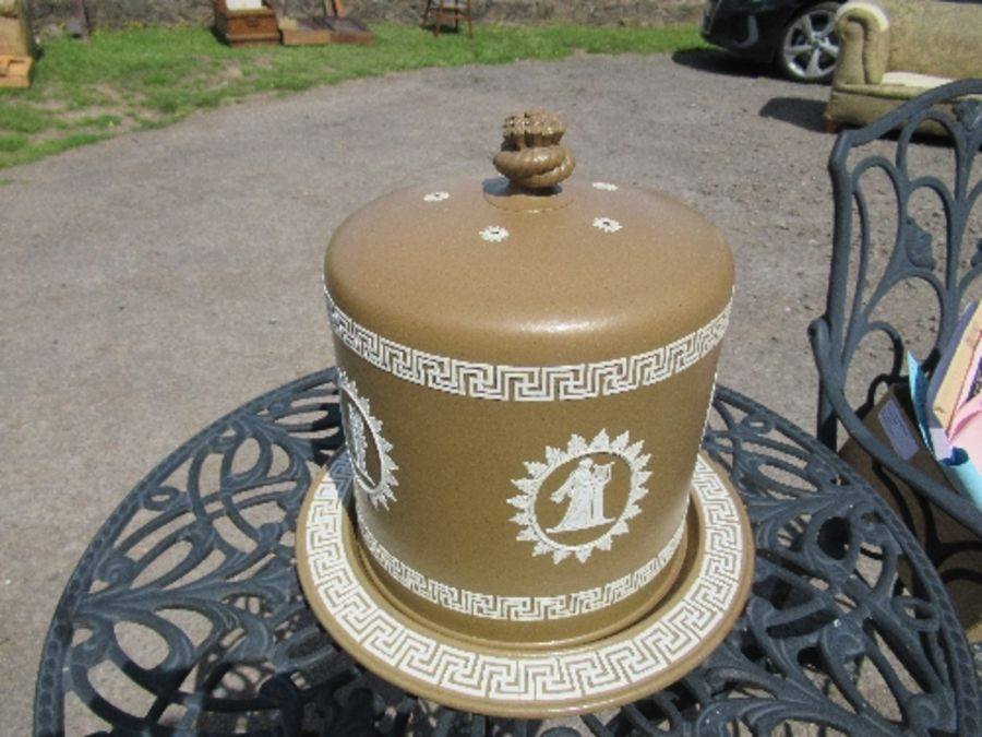 A Wedgwood style brown basalt stilton cover and stand, decorated all around with panels of