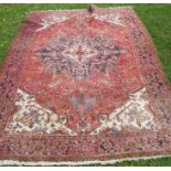 An Eastern style rug, with red ground and white ground spandrels, 78ins x 108ins