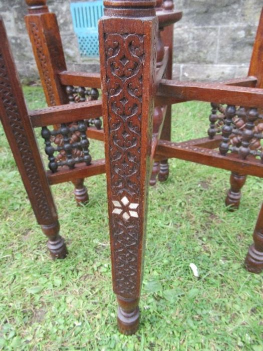 A brass Benares topped table, the wooden folding base with carved and inlaid decoration, diameter - Image 4 of 4