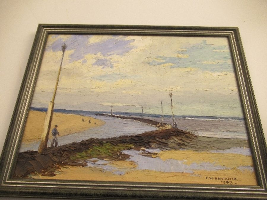 An oil on board, beach scene, signed F.W. Bannister, 1943, 11ins x 13ins