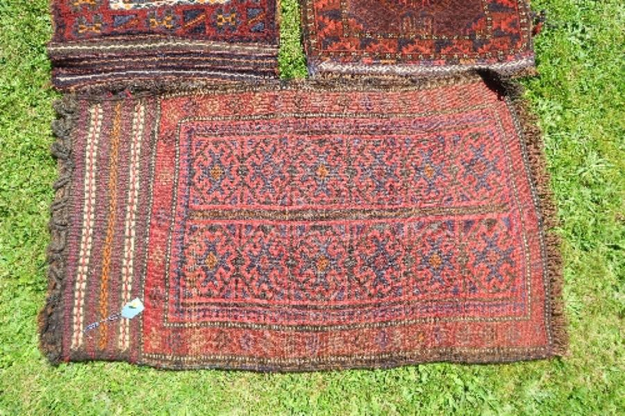 Four Eastern mats, all decorated with different designs to a red ground, all approximately 20ins x - Image 3 of 6