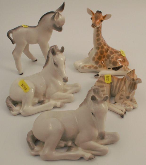 Five USSR porcelain models, of animals, two horses, a donkey, a giraffe and a zebra