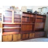 A teak, oak and rosewood bookcase unit, in the Danish style, manufactured by Sejling Skabe,