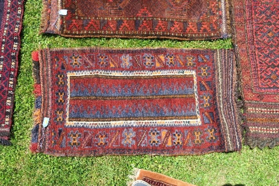 Four Eastern mats, all decorated with different designs to a red ground, all approximately 20ins x - Image 4 of 6