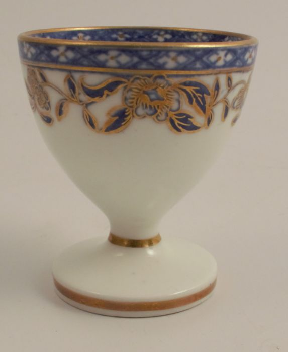 A 19th century Swansea egg cup, having a label to the base ' Swansea China Sidney Heath Collection',