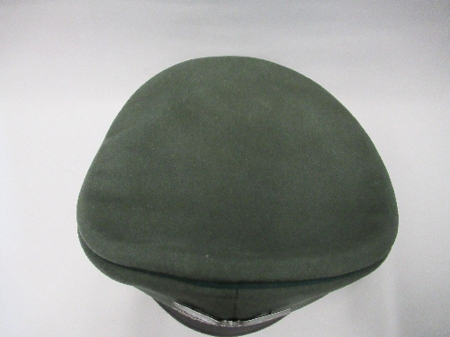 A Third Reich style visor cap, in green felt fabric with dark green piping and hat band, silver - Image 2 of 5