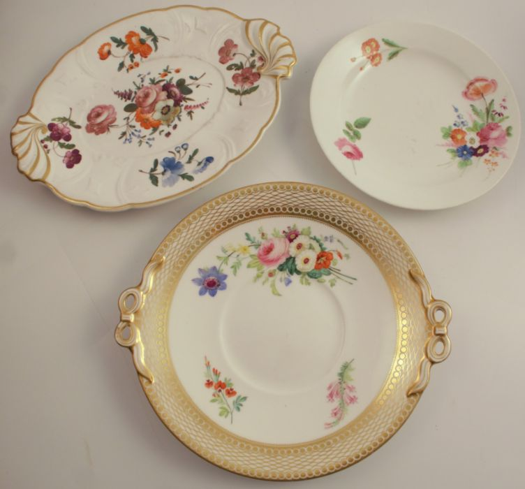 A 19th century Swansea plate, decorated with floral sprays, diameter 8ins, together with a 19th