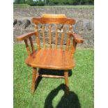 A pine Windsor spindle back captain's chair