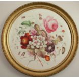 A circular porcelain plaque, painted with flowers, diameter 12ins