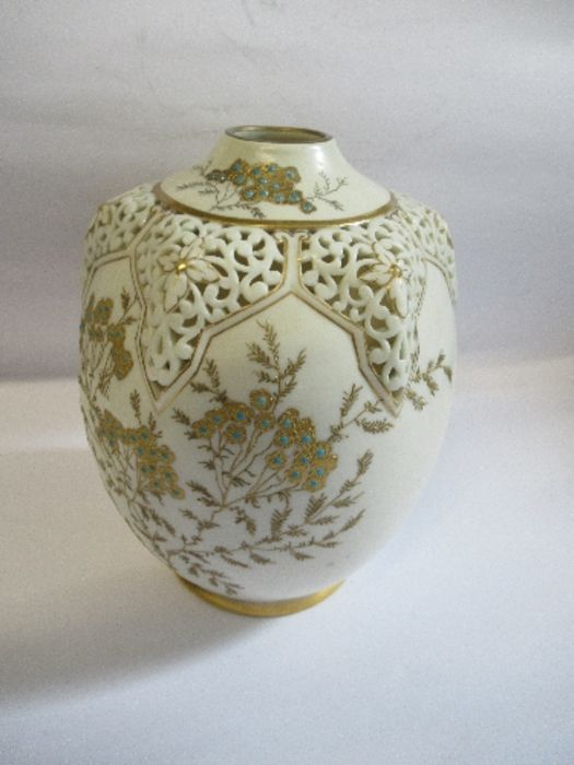 A Royal Worcester gilded ivory vase, with pierced decoration around the neck, shape number G61,