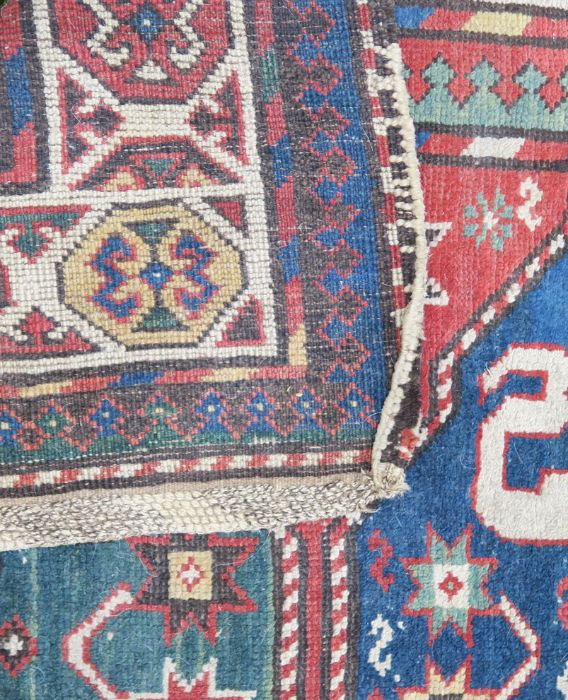 An Eastern style rug, the blue ground field having repeating motifs, 48ins x 95ins, together with - Image 2 of 5
