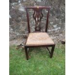 A Chippendale style dining chair, with pierced back and drop in seat