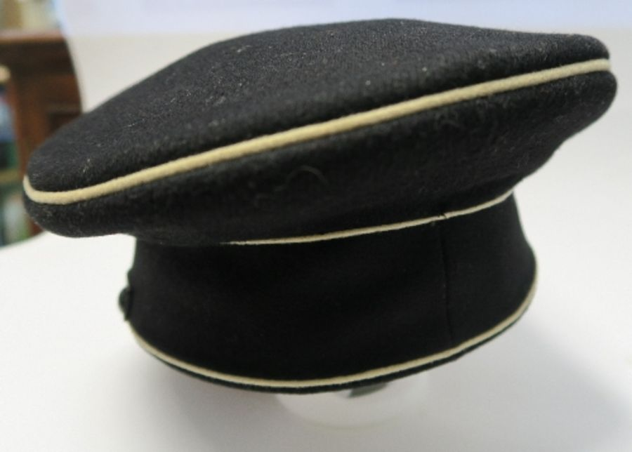 A WW2 style German SS visor cap, in black with white piping, bearing metal SS eagle and skull badges - Image 3 of 6