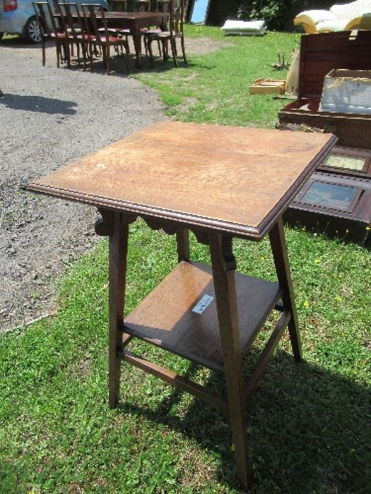 An Arts and Crafts style square topped side table, raised on outswept legs united by a shelf, - Image 4 of 4