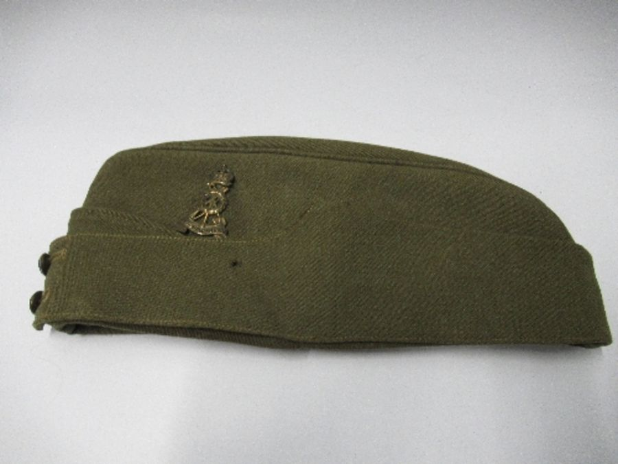 A British naval style visor cap in white cotton, with anchor and crown to the front on a black hat - Image 8 of 13