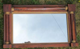 A rosewood framed wall mirror, of rectangular form with half column decoration, overall 17ins x