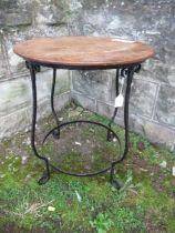 A Bromsgrove Guild occasional table, the circular oak top over wrought iron base, diameter 18ins x