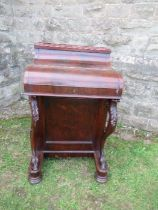 A 19th century rosewood piano top Davenport, having secret writing compartment and rising lid,