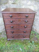 A 19th century late Georgian oak miniature chest of drawers, having five graduated drawers with