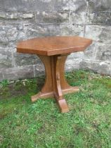 A Robert Mouseman Thompson oak octagonal occasional table, with adzed finish, height 19ins,