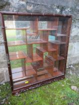 An Eastern hardwood hanging display cabinet, height 23ins, width 19ins