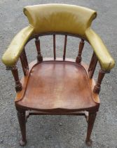 A mahogany desk chair, the curved back with upholstered upper section, raised on turned spindles and